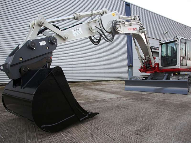 Hill Engineering quick-coupler on a Takeuchi excavator